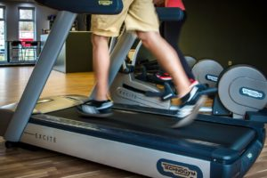 Person running on treadmill | OVitaminPro.com