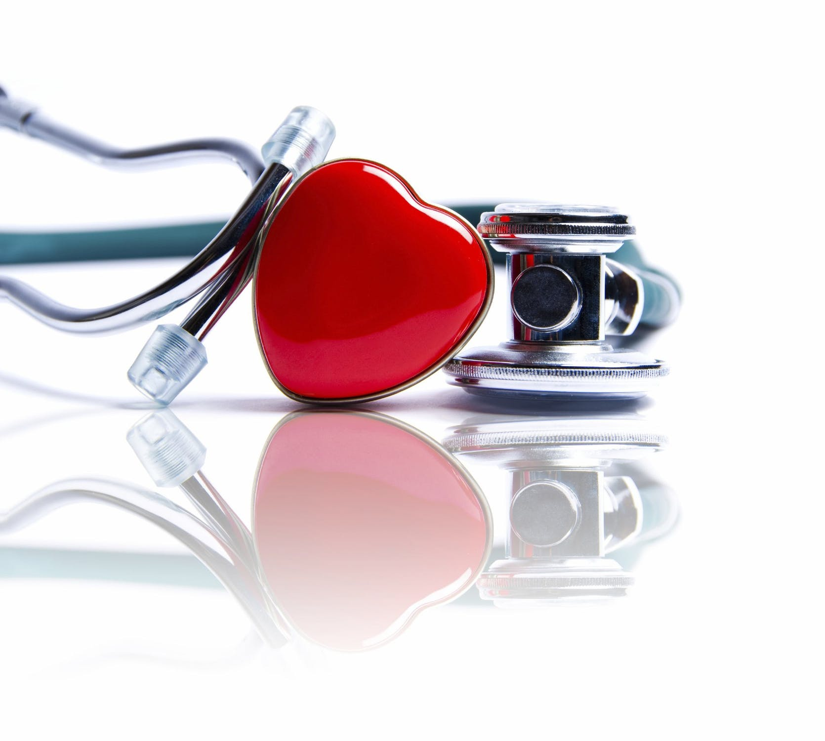 A red heart trinket next to silver stethoscope | OVitaminPro.com